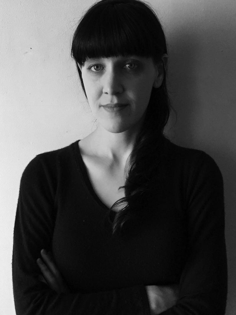 Black and white headshot of Tess Clancy
