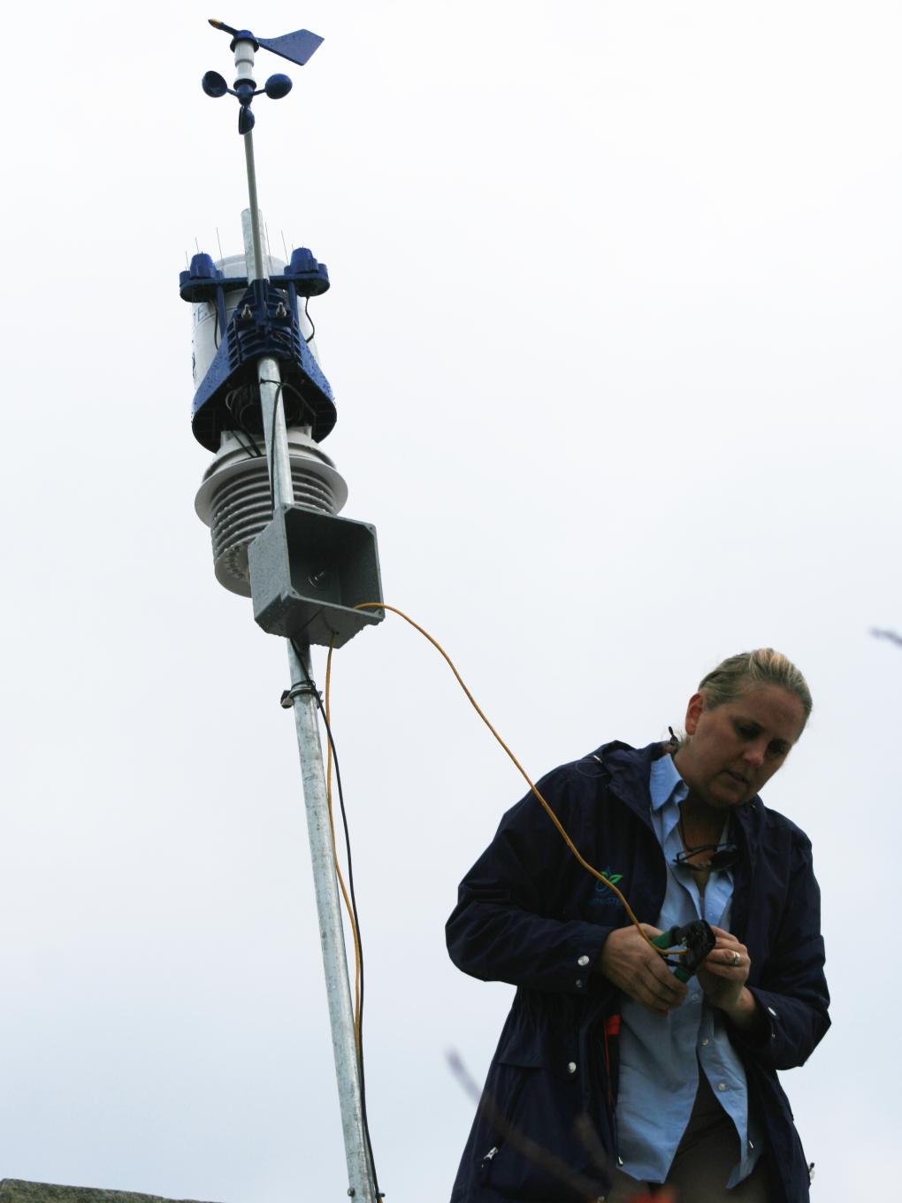 Woman installing weather unit