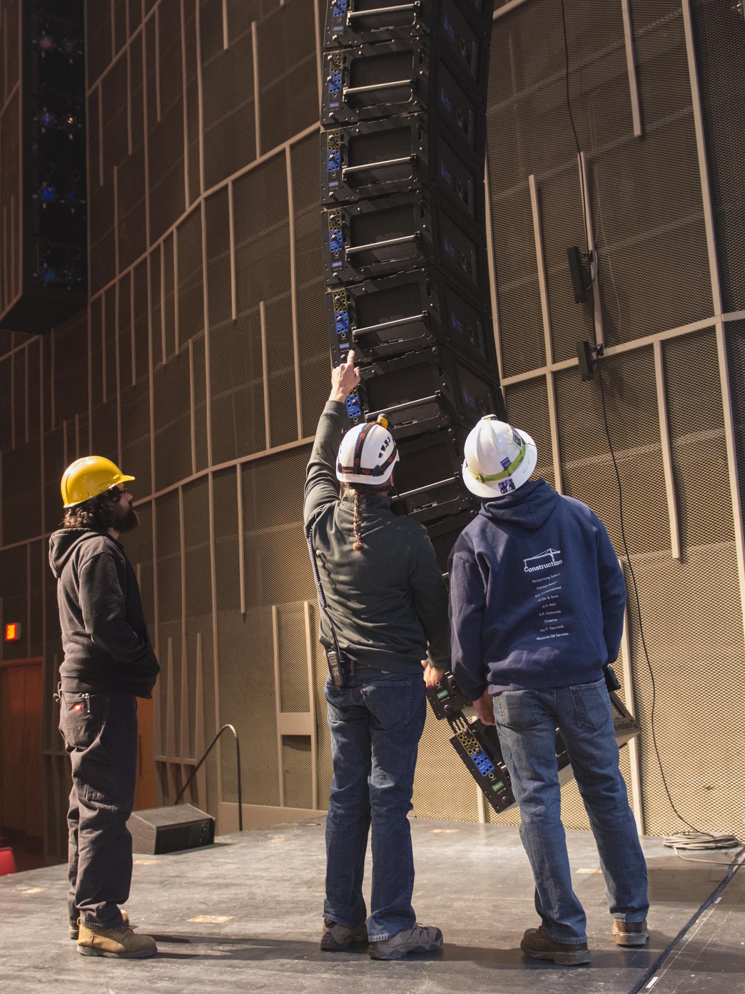 Raising speakers into place