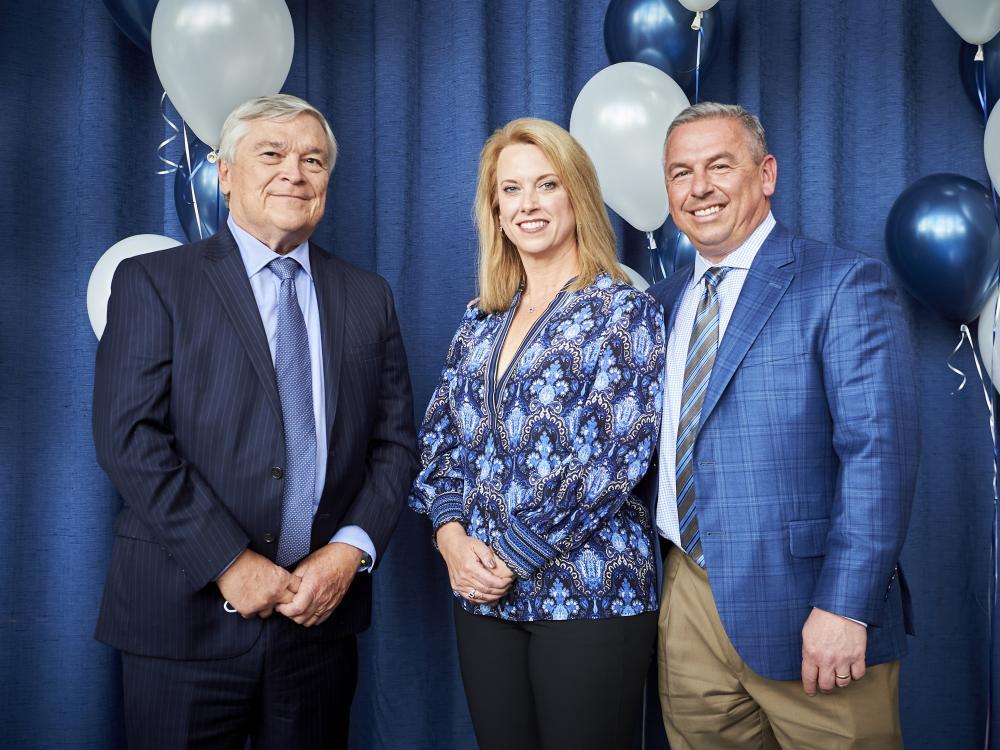 A photo of Penn State President Eric J. Barron with Jason and Julie Borrelli.