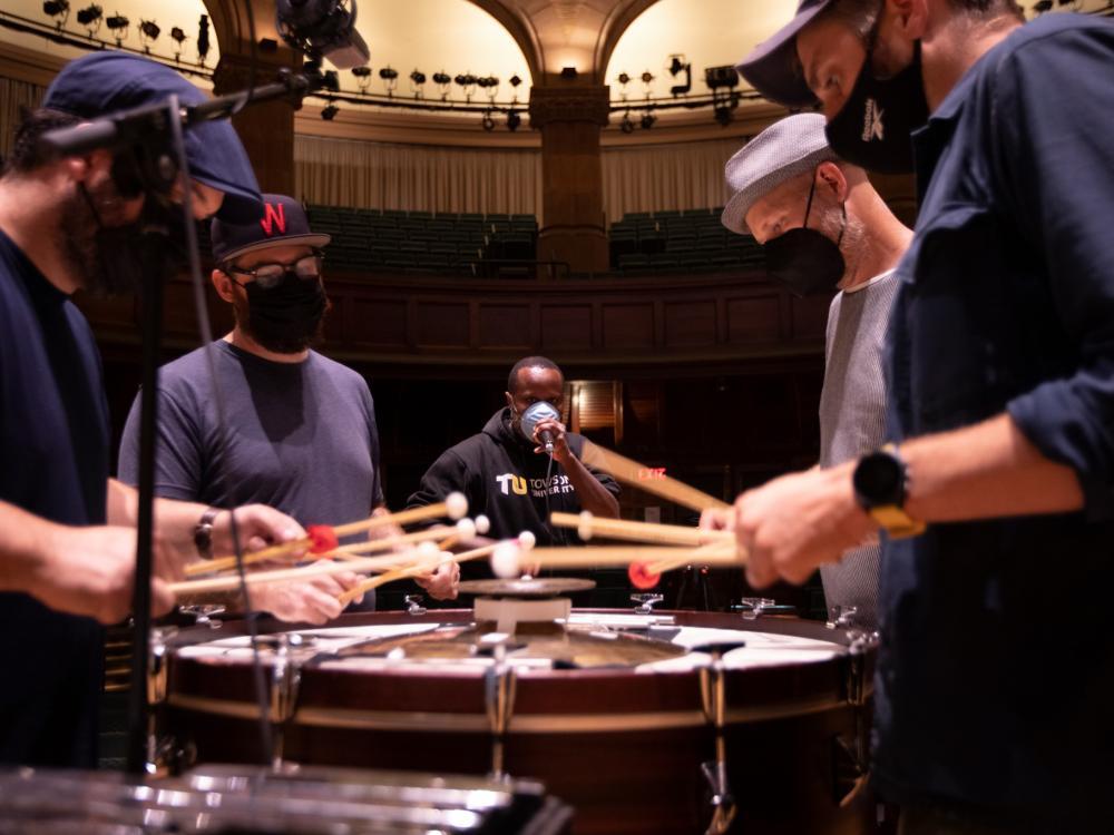 Dominic Shodekeh Talifero, at center, beatboxes with the ensemble So Percussion