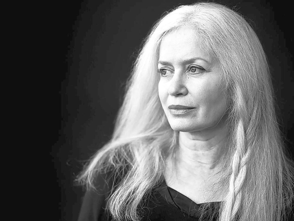 A black-and-white portrait of the author Amy Hempel