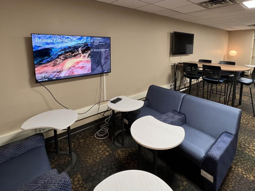 lounge-style chars, tables, and digital monitors set up in the newly redesigned Beaver Hall computer lab