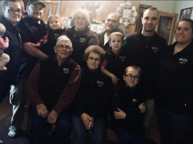 The family of Big Maple Family Farm stands together for a photo.