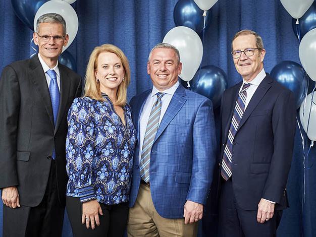 A photo of Brent Ambrose, Julie Borrelli, Jason Borrelli and Dean Charles H. Whiteman