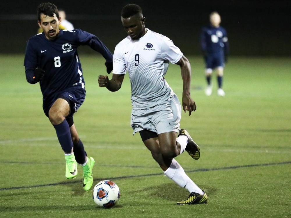 Mohamed Camara dribbles past a defender