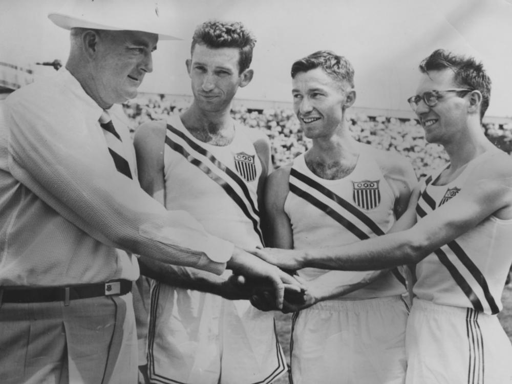 Coach Chick Werner, Horace Ashenfelter, William Ashenfelter, and Curt Stone are ready for the 1952 Helsinki Olympics.