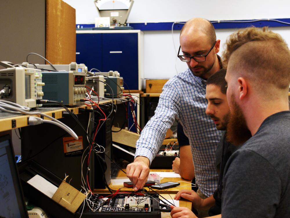 EMET professor and students in lab