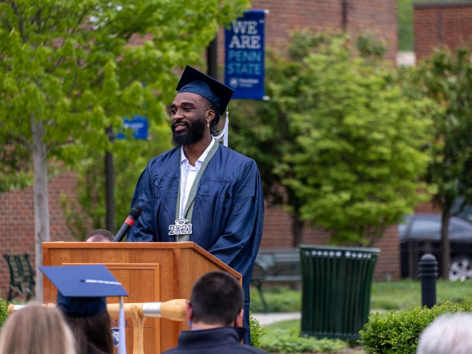 Donovan Verges speaking at podium at commencement