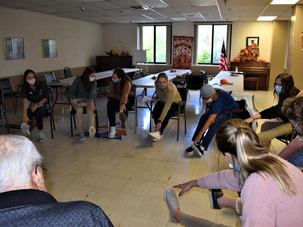 Penn State DuBois Occupational Therapy Assistant students lead area senior residents in fall prevention exercises.