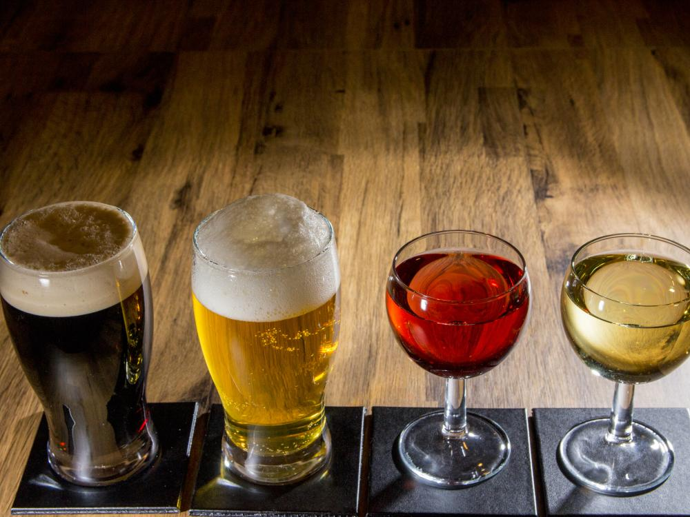 Four alcoholic drinks lined up on a table