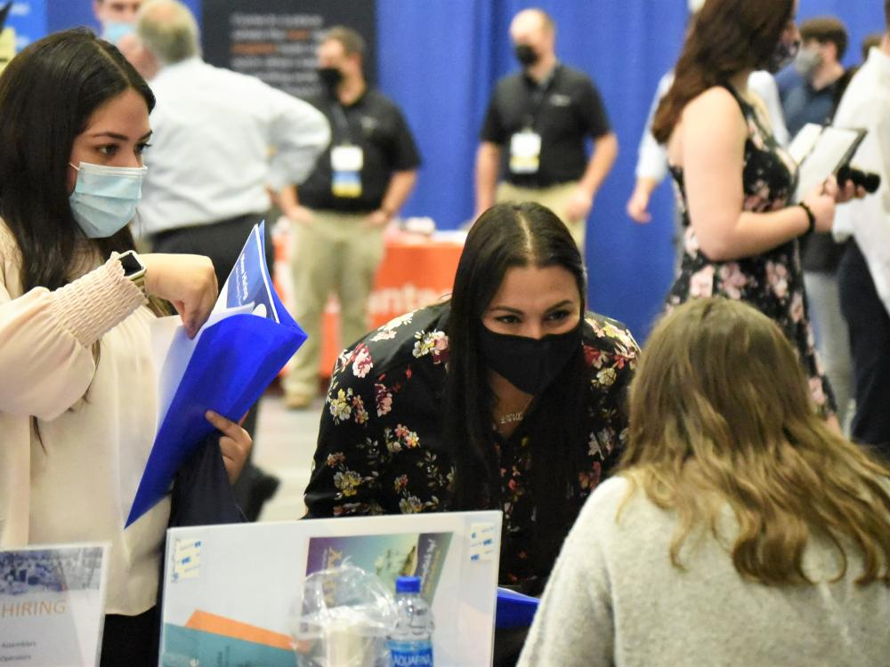 Students talk with a recruiter during the Penn State Behrend fall 2021 Career and Internship Fair.