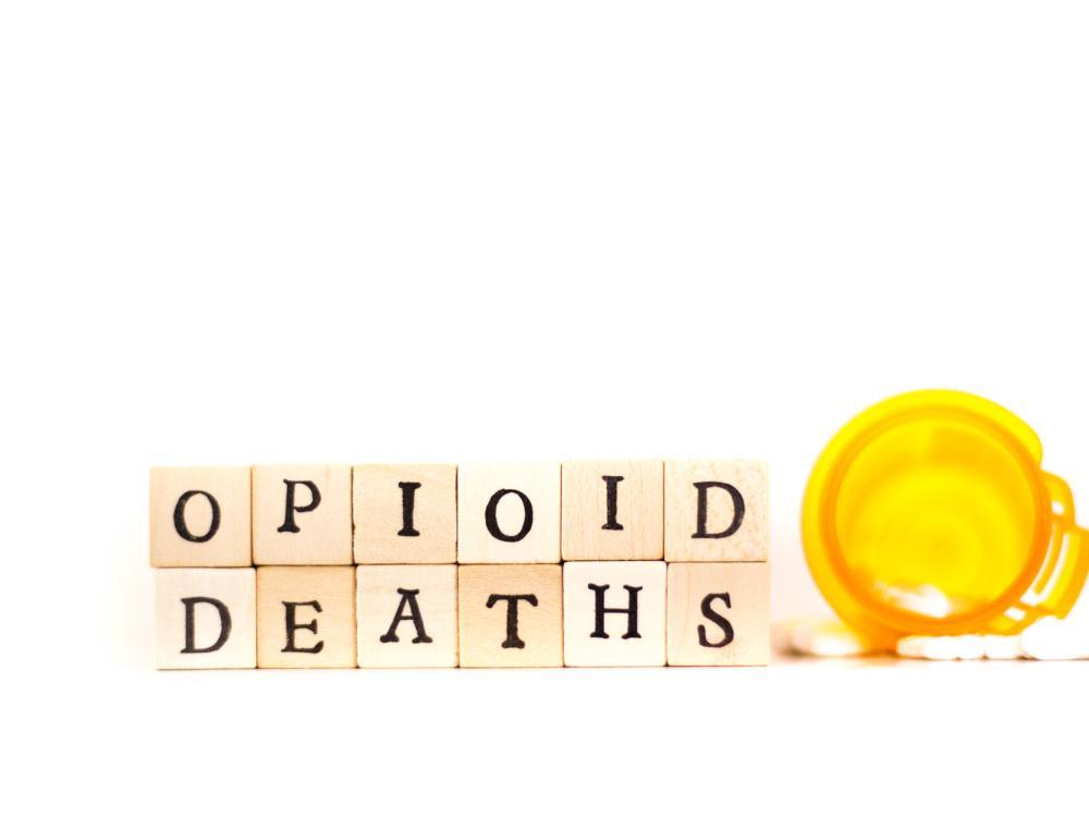 "The words ""Opioid deaths"" written in wooden tiles"