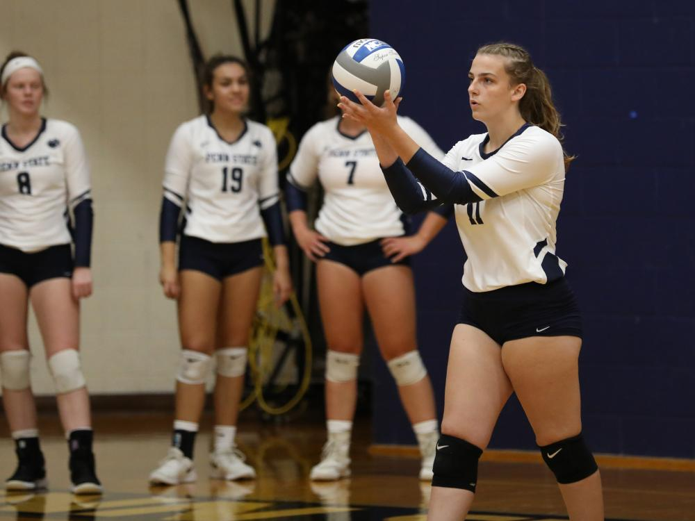 Penn State Brandywine first-year student Lexie Berry prepares to serve during a volleyball match.