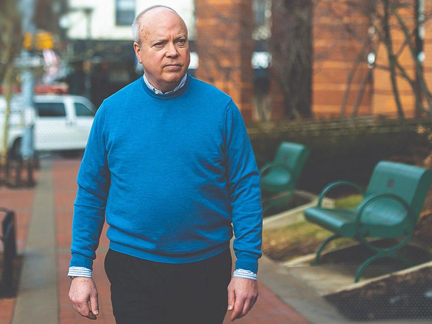 Penn State's Tom Sharbaugh walks in downtown State College.