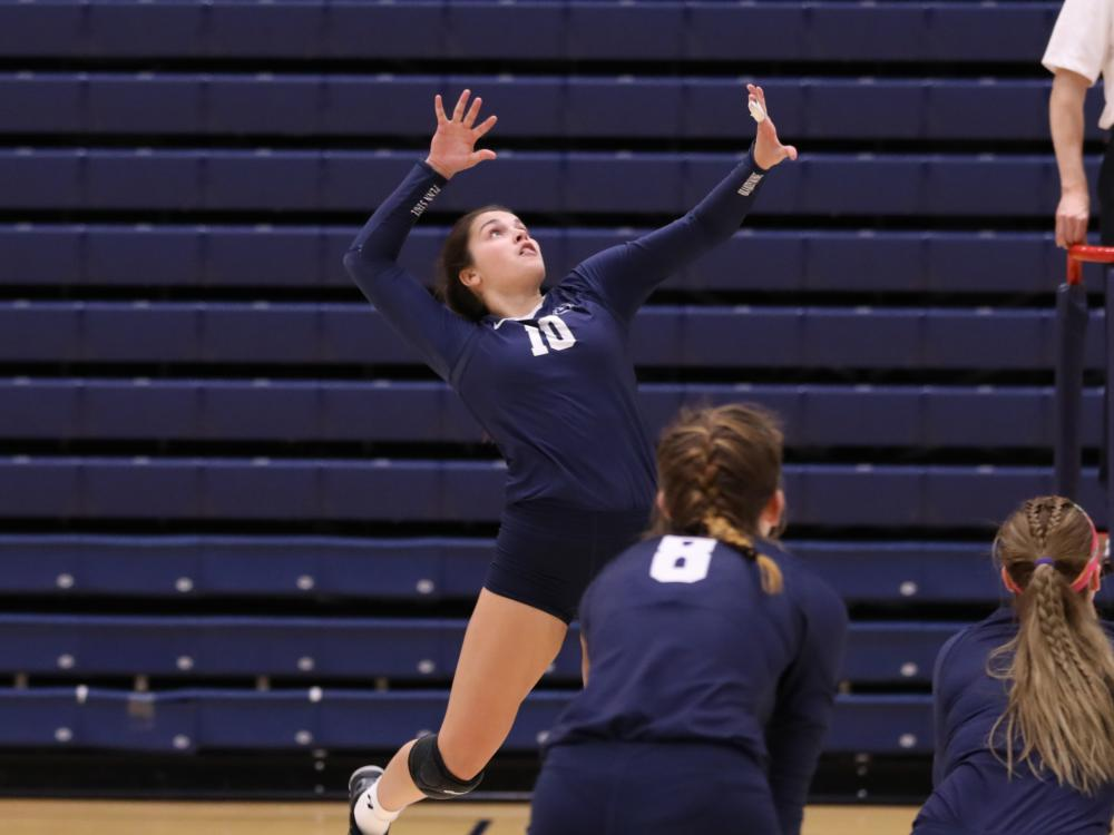 Nikki Poissant swings for a point at the PSUAC Championship