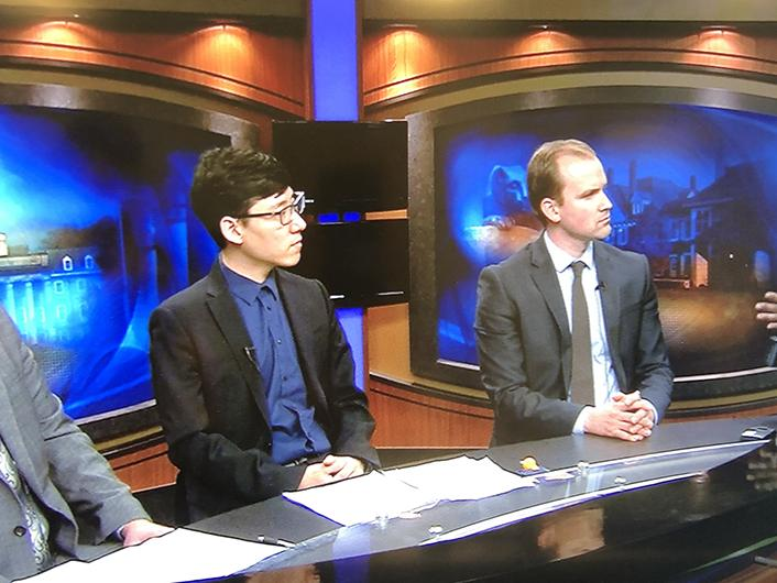 Students participate in a simulated prime-time news panel