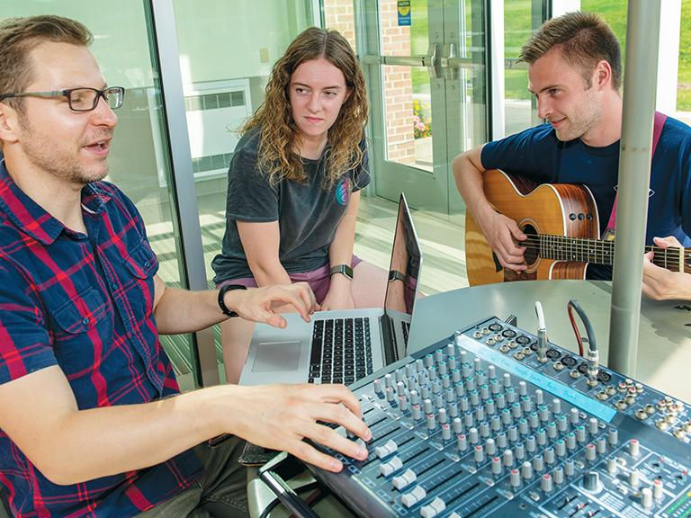 A Penn State Behrend professor and two students record music for a new praise album.