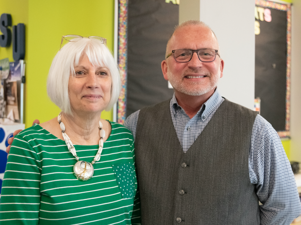 Cheryl Tkacs (left), instructional designer, celebrates her retirement from Penn State Fayette after fifteen years, with Charles Patrick (right), chancellor and chief academic officer.