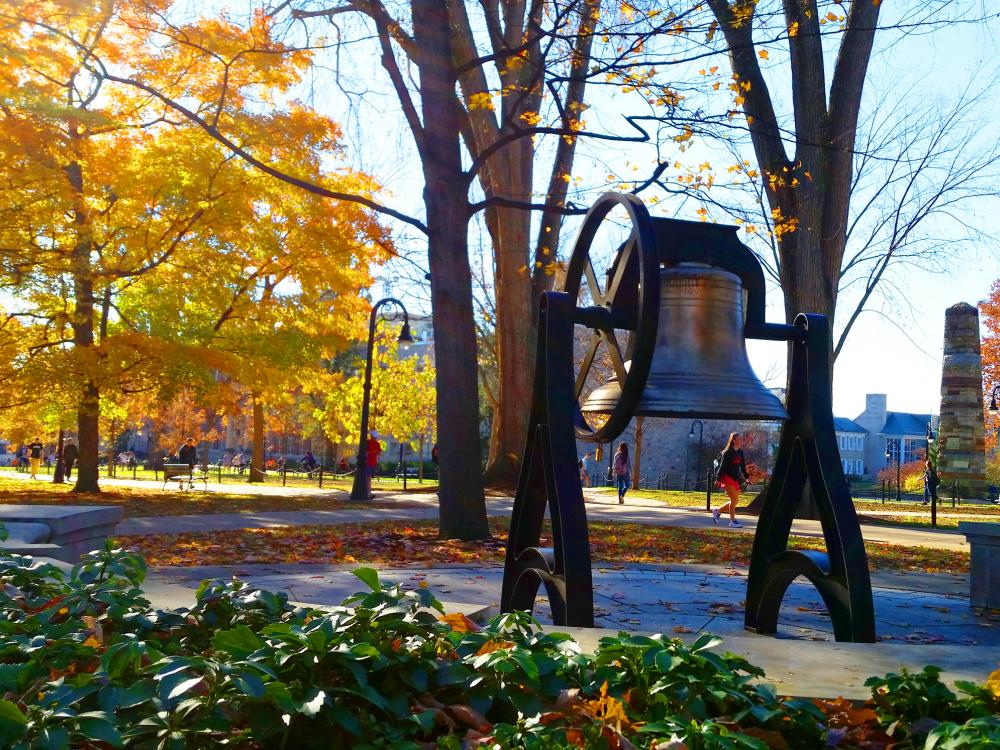 A photo of the Old Main Bell in fall.