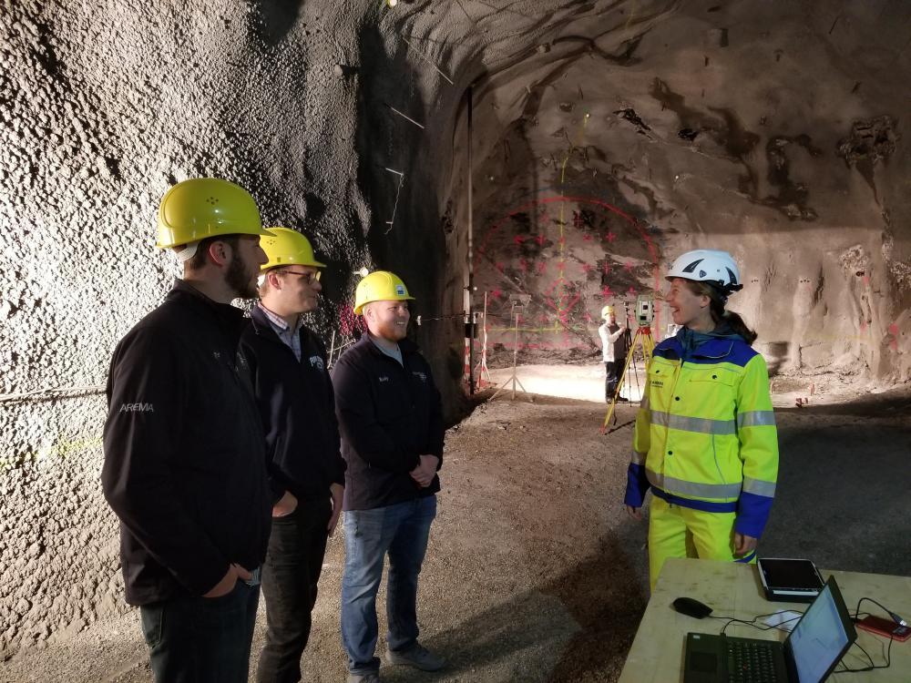 Students and Joe Scott speak with engineer before working on 360-degree video in Europe