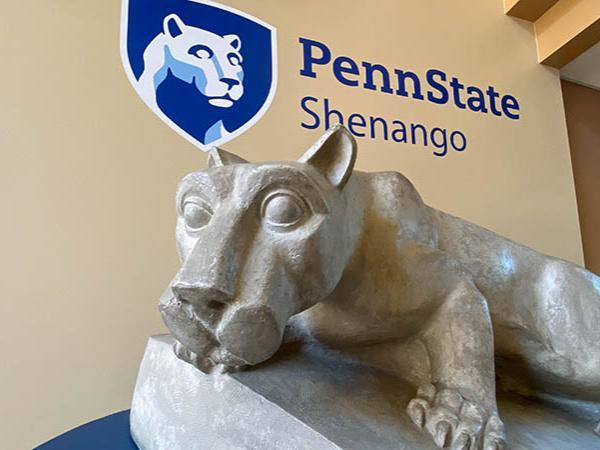 Lion Shrine statue under Penn State Shenango mark