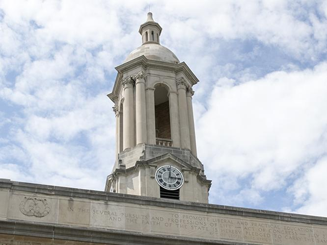 Old Main Bell Tower against Blue and White Sky