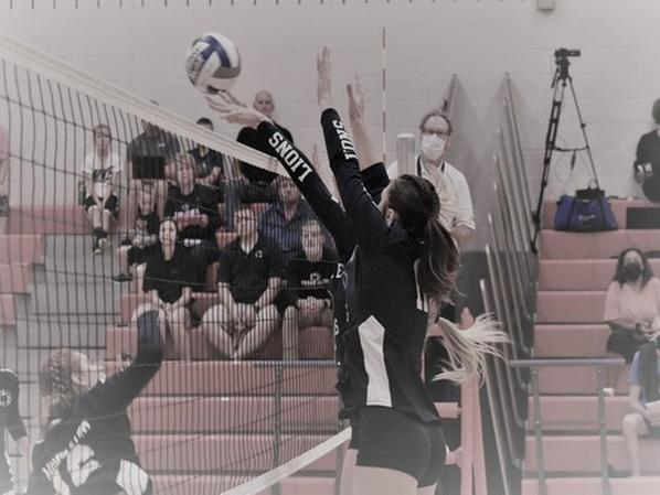 DuBois at the net in a weekend volleyball match.