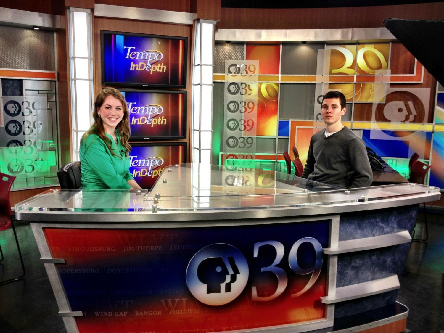 Penn State Lehigh Valley students sit behind the news desk at the WLVT studio.
