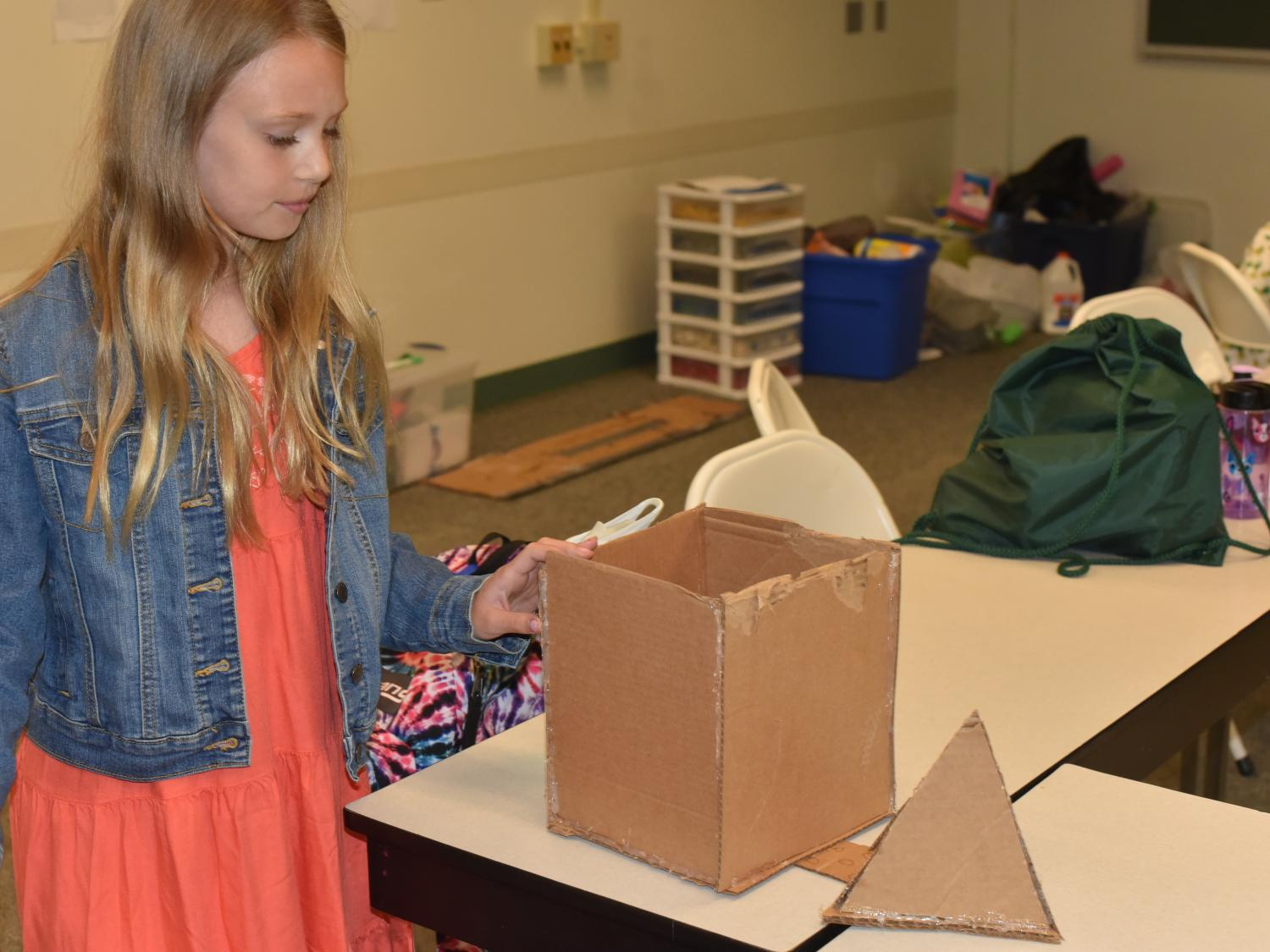 """Linnea Henderson works to construct a dream home during the """"Engineer and Build Your Dream Home"""" class at Penn State Behrend's College for Kids."""