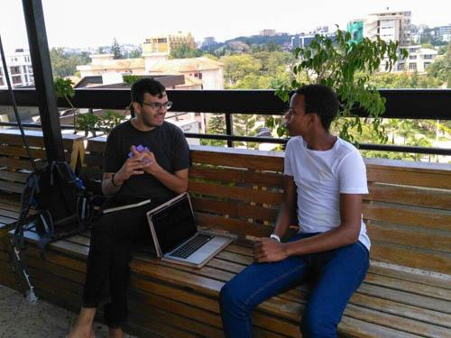 Eric Obeysekare interviews an entrepreneur in Rwanda.