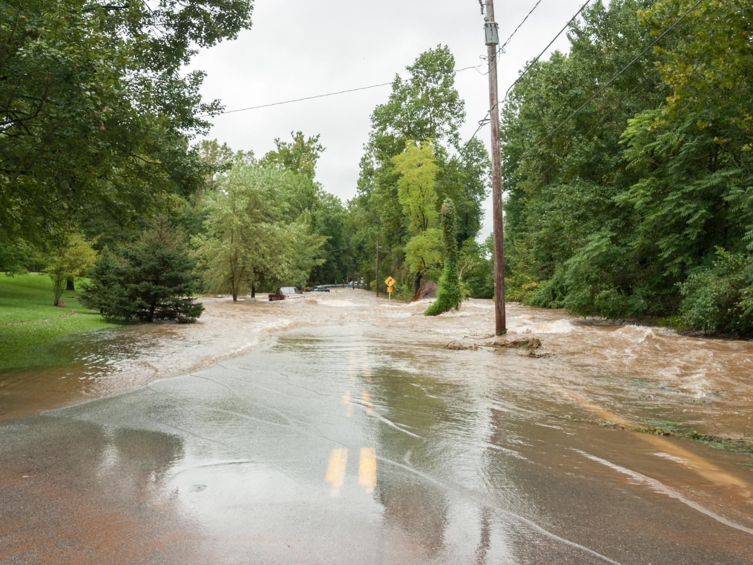 Flooding causes damage property and roadways