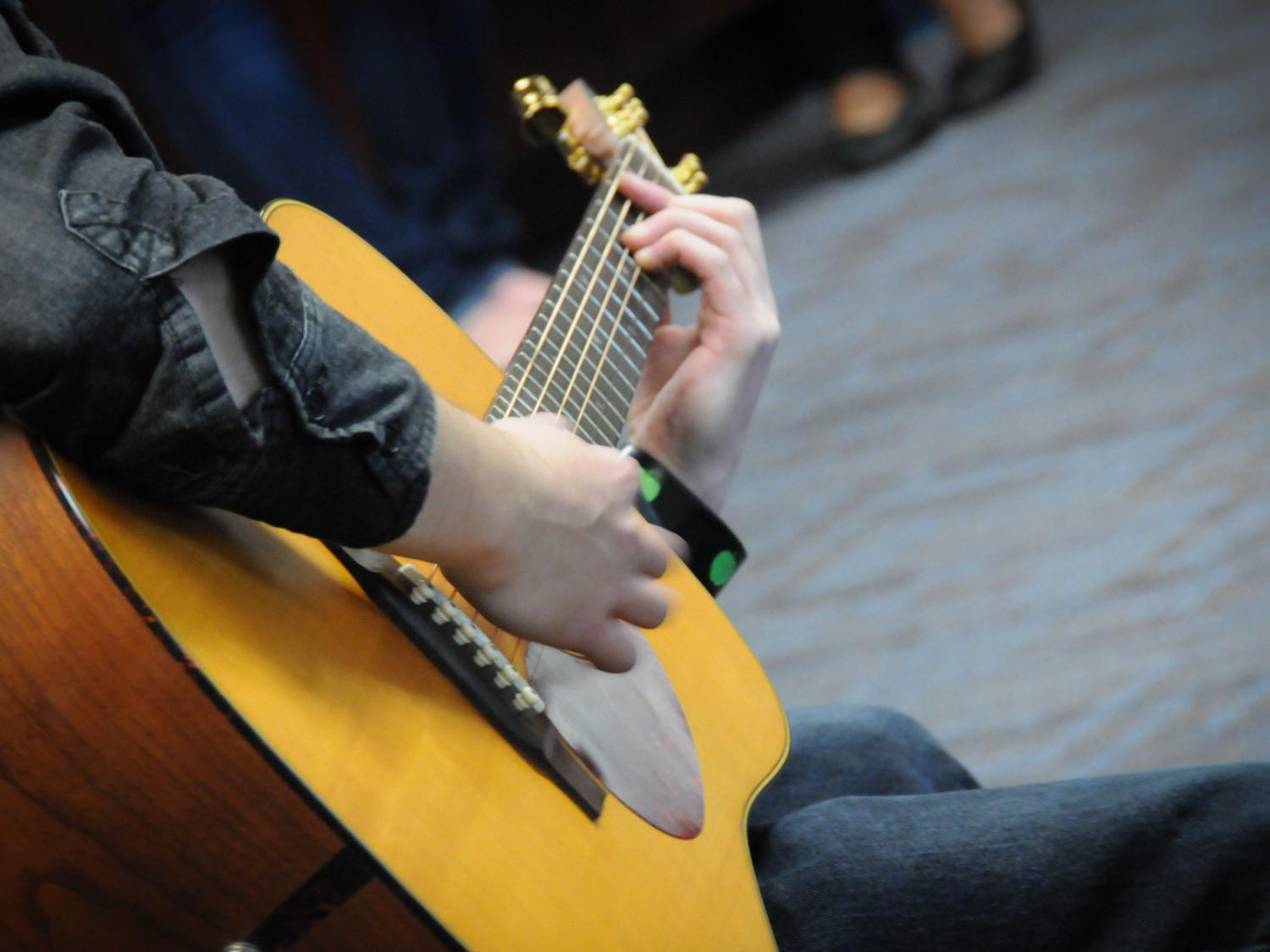 A Lehigh Valley student plays guitar during a campus performance.