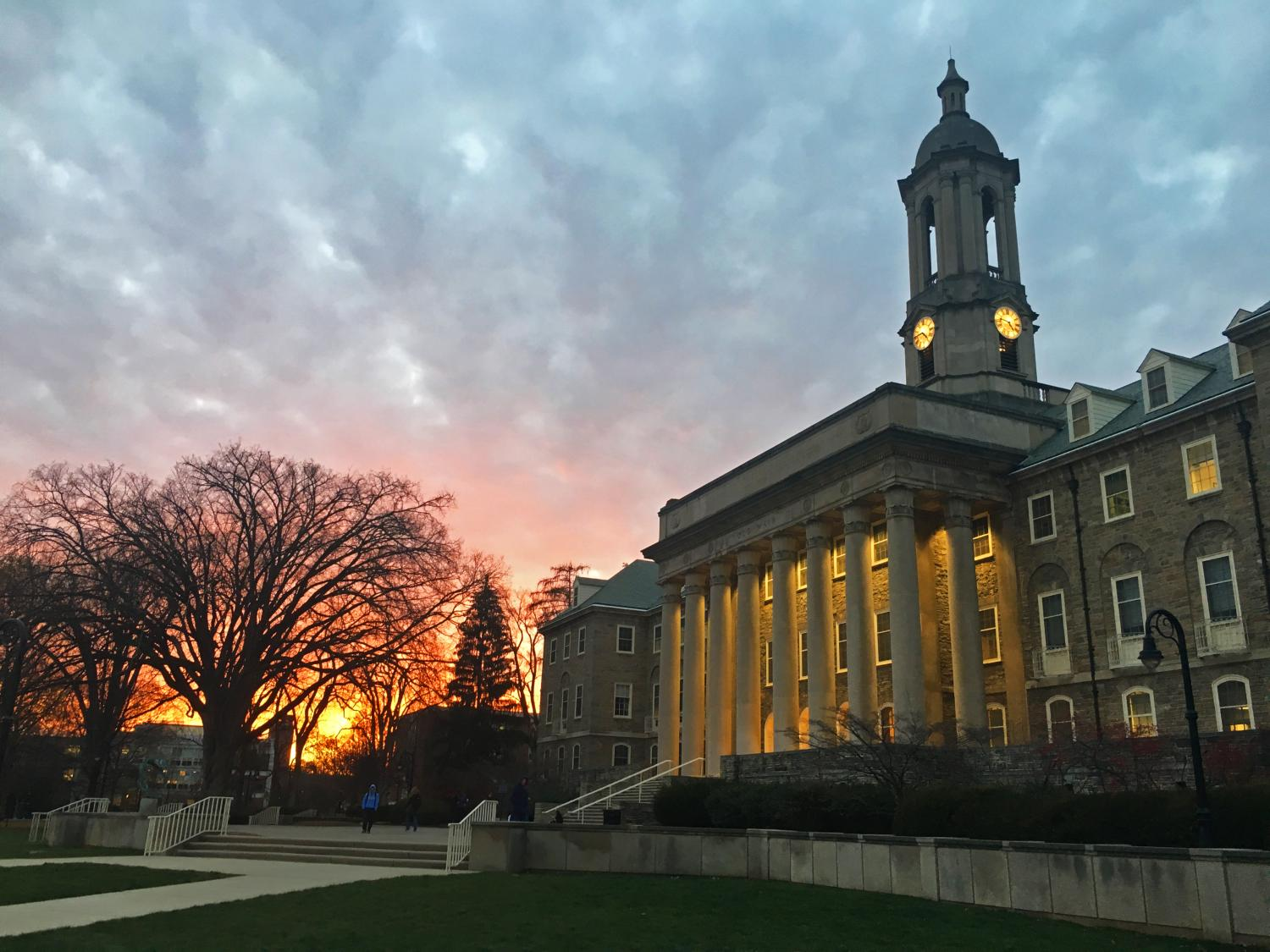 Penn State's Old Main building at sunset.