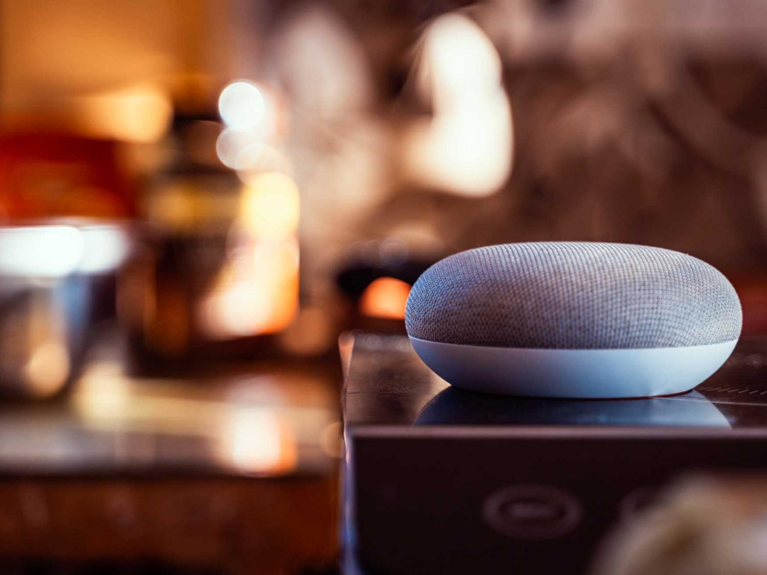 A Google Home smart device sits on a surface.