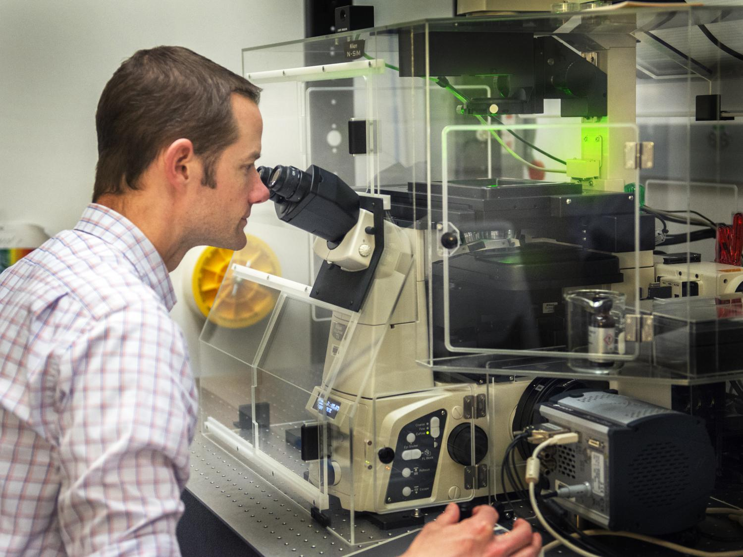 Charles Anderson with super microscope