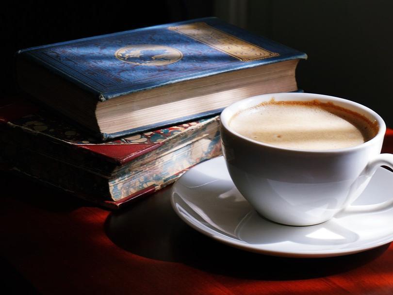 photo of old books and coffee cup