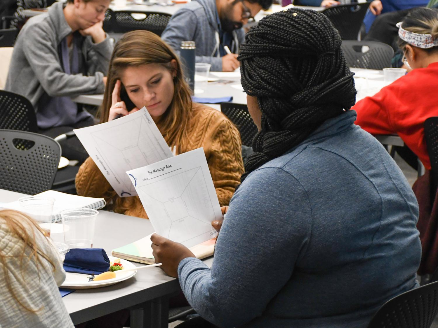 Graduate students review their message box tool during a science communication workshop in 2019.