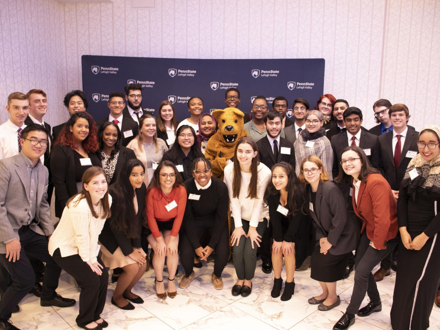 group of students with nittany lion mascot