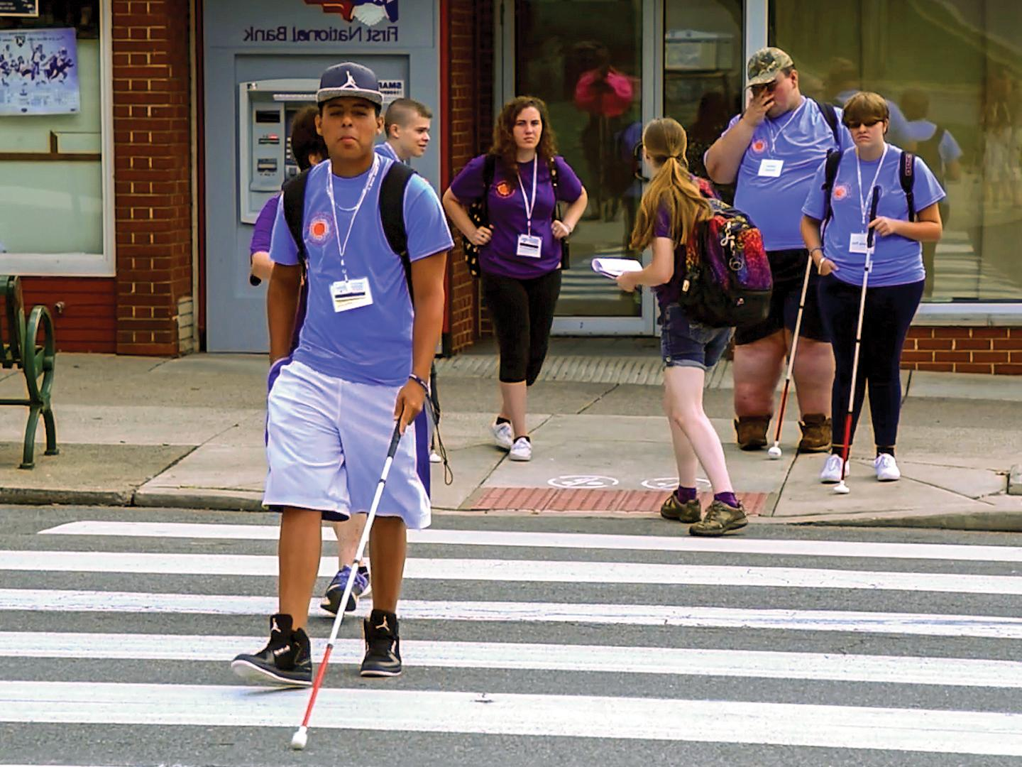 Students in the Summer Academy navigating a crosswalk.